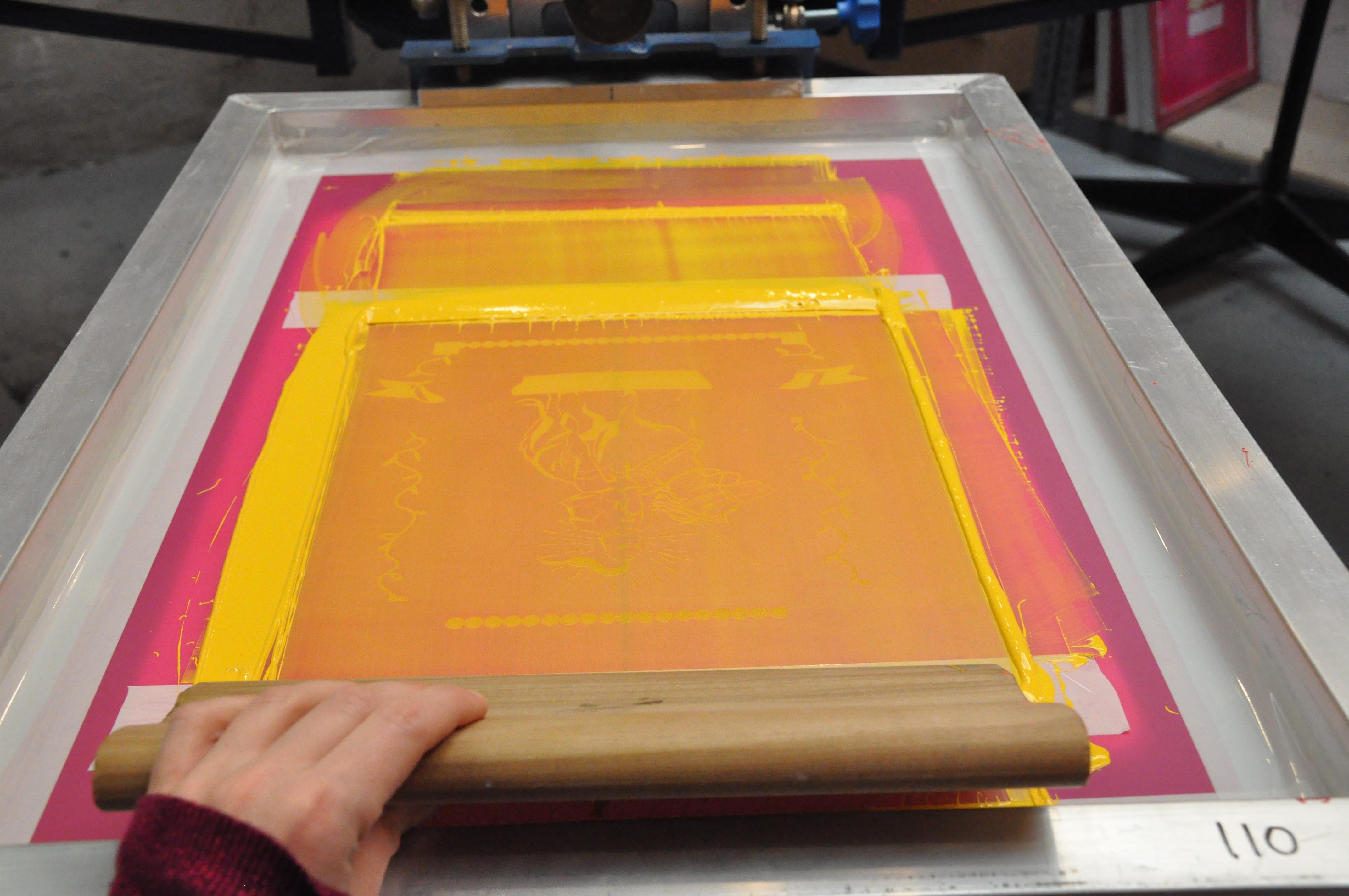pulling ink over exposed screen, custom screen printing